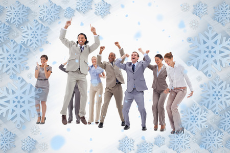 Very enthusiast business people jumping and raising their arms against snowflake frame photo