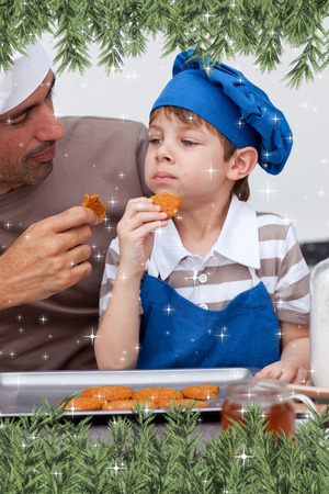 Composite image of a Father and son eating cookies against twinkling stars photo