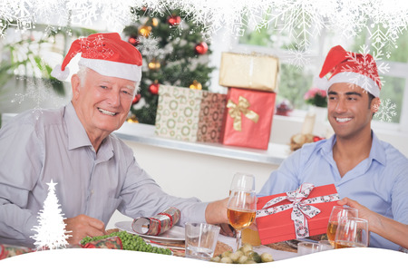 swapping: Family swapping christmas presents against fir tree forest and snowflakes Stock Photo