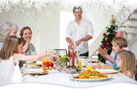 Family enjoying Christmas meal at dining table against fir tree forest and snowflakes photo
