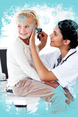 Cute little girl attending a medical checkup against christmas frame photo