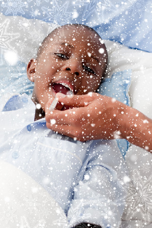 Small Boy sick in bed against snow falling Stock Photo