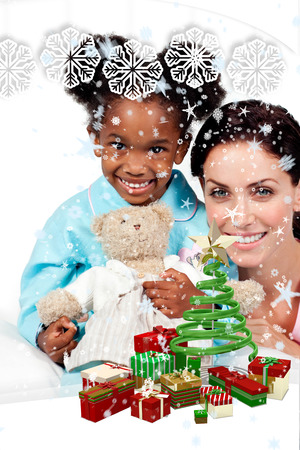 Composite image of a Smiling little girl with her nurse looking at the camera  against snow falling photo