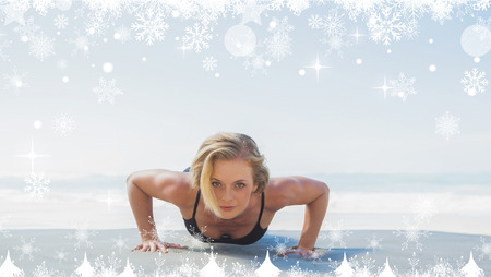 plank position: Composite image of a Fit blonde in plank position on the beach against twinkling stars Stock Photo