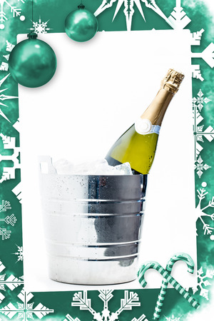 Christmas frame against bottle of champagne chilling in ice bucket photo