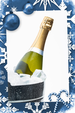 Christmas frame against champagne cooling in ice bucket photo