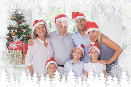 Family posing for photo against fir tree forest and snowflakes photo