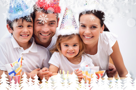 Family celebrating daughter against fir tree forest and snowflakes photo