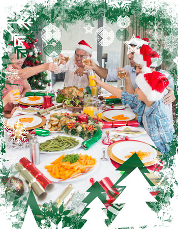 Family in santas hats toasting wine glasses at dining table against christmas themed frame photo
