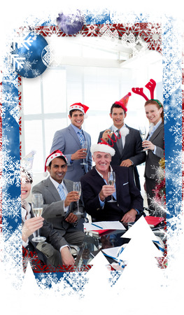 Business people with novelty Christmas hat toasting at a party against christmas themed frame photo