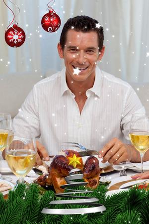 Smiling man eating turkey in Christmas dinner against twinkling stars