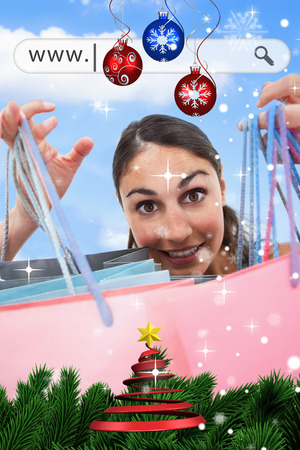 address bar: Woman holding up her shopping bags under address bar against snow falling