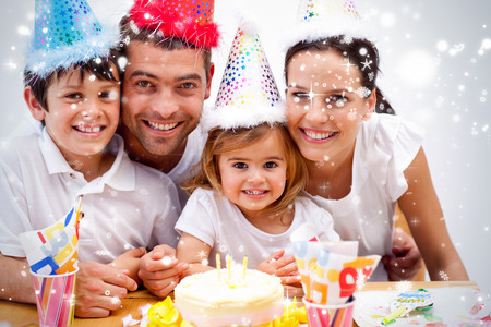 Composite image of Family celebrating daughter against snow falling photo