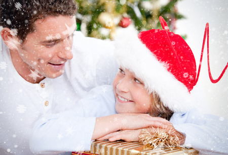 Composite image of Attractive father celebrating christmas with his son against snow photo