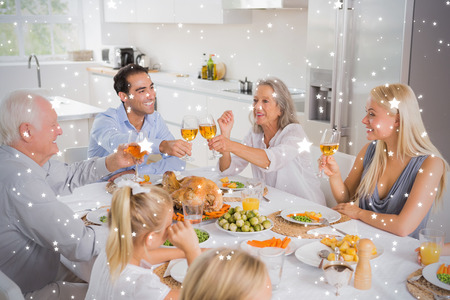 composite image: Composite image of Smiling adults raising their glasses against snow