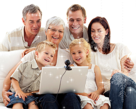 Composite image of happy family in a video conference against snow photo