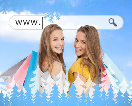 address bar: Smiling girls with their shopping bags under address bar against frost and fir trees