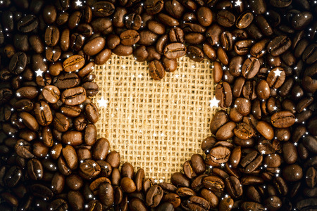 indent: Snow against heart indent in coffee beans Stock Photo