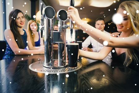 beer pump: Composite image of Blonde woman pulling a pint of stout against snow
