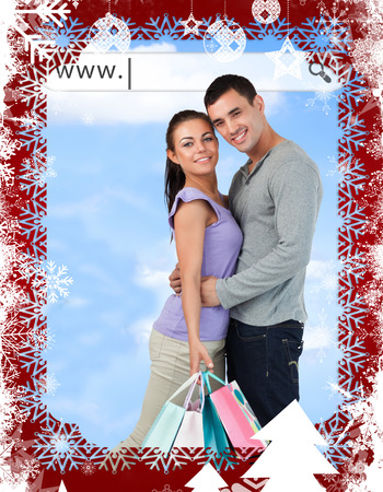 address bar: Happy couple with their shopping bags under address bar against christmas themed frame