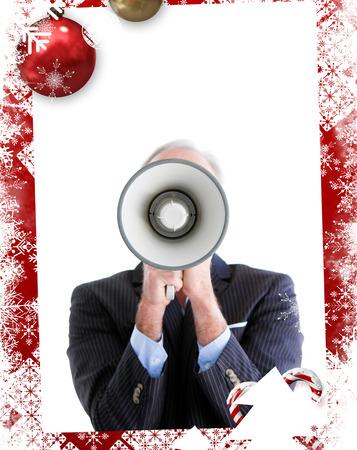 businessman using a megaphone: Senior businessman using a megaphone  against christmas themed frame Stock Photo