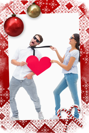 Brunette pulling her boyfriend by the tie against christmas themed page photo