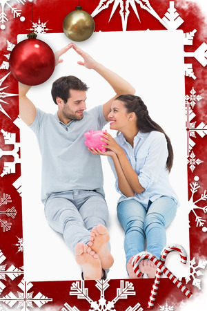 Cute couple considering a mortgage against christmas themed page photo