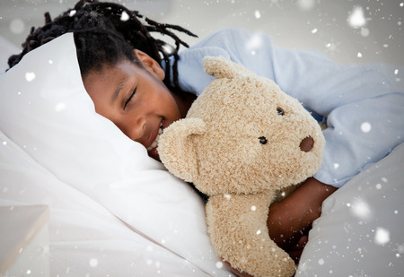 Composite image of young boy in hospital against snow falling photo