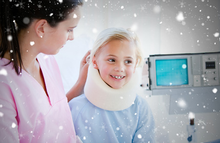 neck brace: Composite image of adorable little girl with a neck brace sitting with her nurse against snow falling