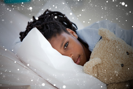 Composite image of young boy in hospital against snow photo