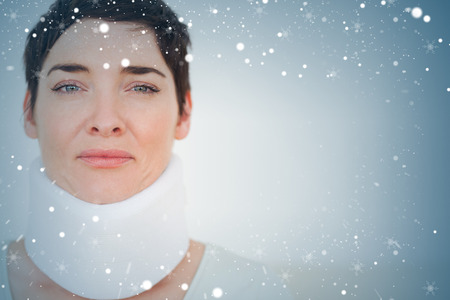 Close up of a sad Woman with a surgical collar against snow photo