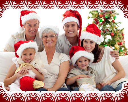 botas de navidad: Ni�os sentados con su familia la celebraci�n de botas de Navidad contra el marco de copo de nieve Foto de archivo