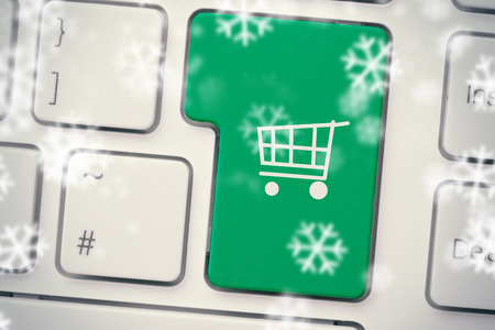 input device: Snowflakes against green trolley button on keyboard Stock Photo
