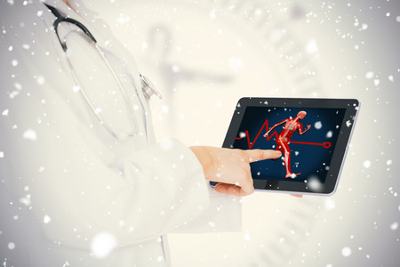 doctor tablet: Doctor showing her tablet with body running against snow falling Stock Photo