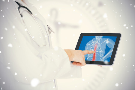 doctor tablet: Doctor showing her tablet with red spin against snow falling