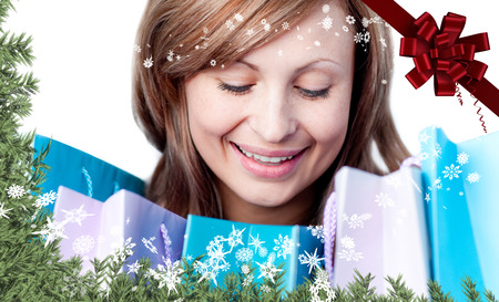 gratified: Beautiful woman with shopping bags against red christmas bow and ribbon