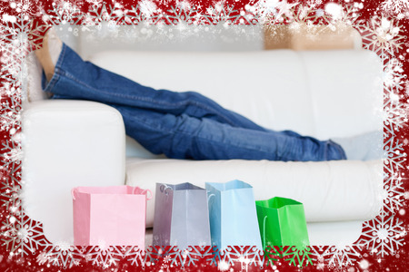Female legs resting on sofa after shopping tour against snow photo