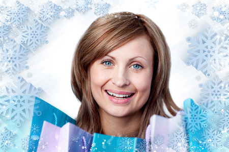 gratified: Composite image of radiant woman with shopping bags against snow Stock Photo