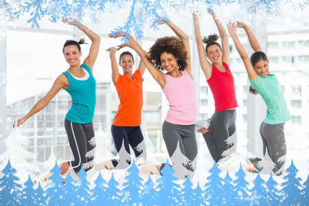 Composite image of snow frame against zumba class in gym