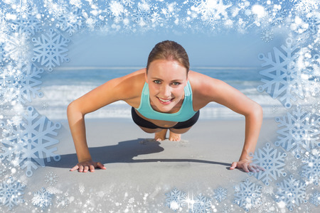 plank position: Composite image of fit woman in plank position on the beach against snow