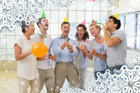 party poppers: Casual business team celebrating with champagne and party poppers against snow