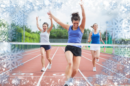 Composite image of athlete celebrates race win at finish line against snow