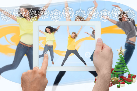 having fun in winter time: Hand holding tablet pc against snowflake frame