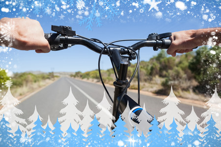 open road: Composite image of cyclist hitting the open road against snow Stock Photo