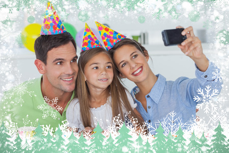 Woman taking pictures of her family during a birthday party against snow photo