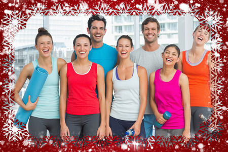 Portrait of fit people smiling in exercise room against snow photo