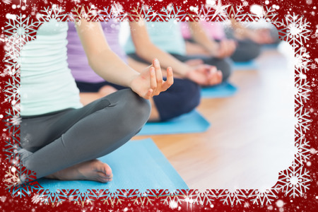 Composite image of snow frame against yoga class in gym photo