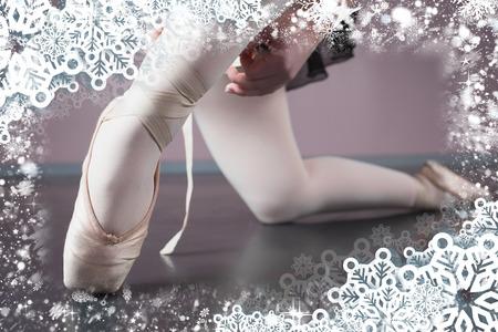 ballet slippers: Ballerina tying the ribbon on her ballet slippers against snow