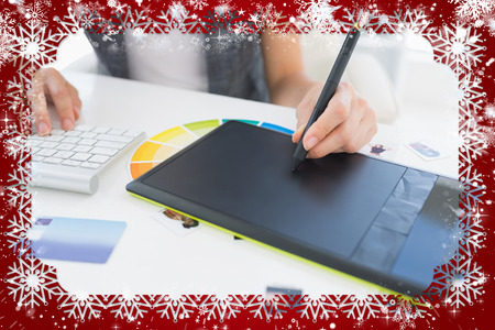 graphics tablet: Female photo editor using graphics tablet against snow