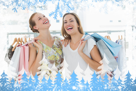 Cheerful women with shopping bags in the clothes store against snow photo